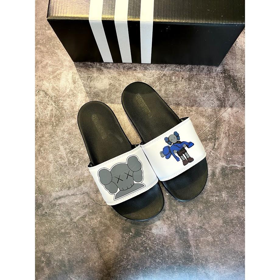 Dép adidas plus kaws đen quai trắng nam