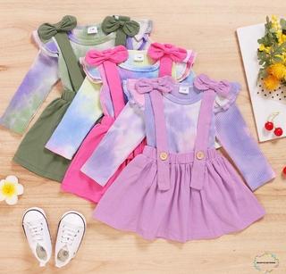 Set Đồ 2 Món Gồm Áo Cổ Tròn Tay Bèo Nhuộm Màu + Chân Váy Yếm Đính Nơ Xinh Xắn Cho Bé Gái