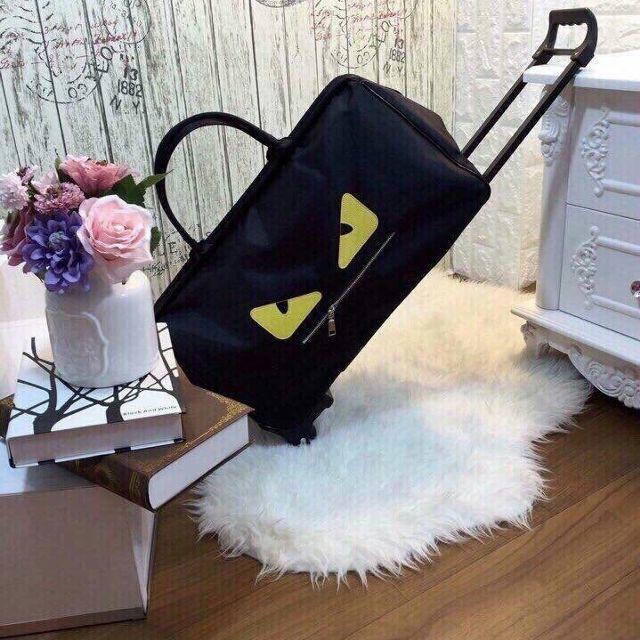Túi vali kéo du lịch Fendi mắt vàng size to