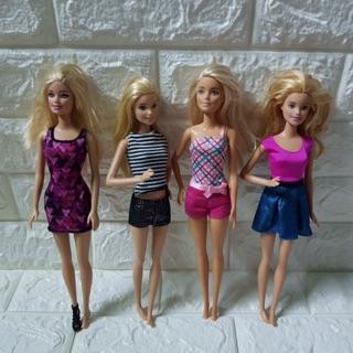 Búp bê Barbie đã qua sử dụng