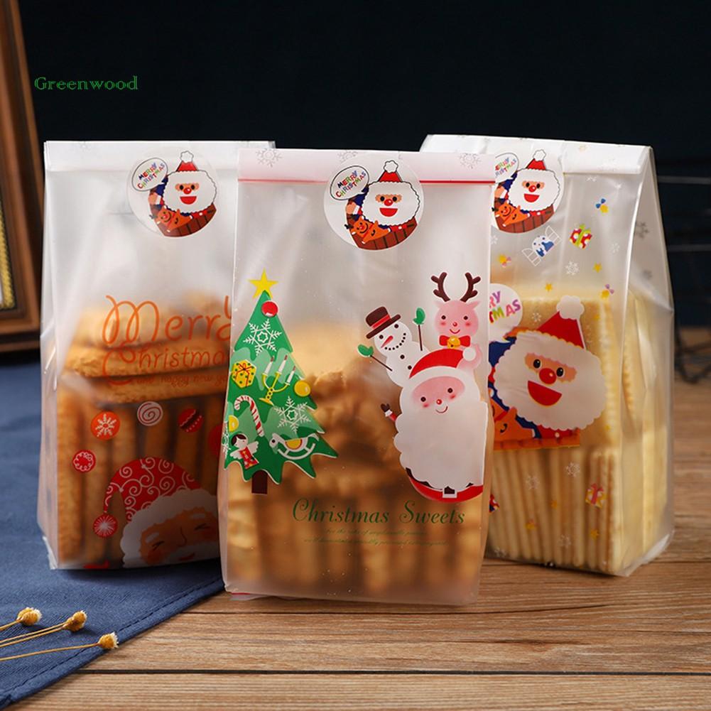 Set 50 túi đựng bánh kẹo in họa tiết Ông già Noel/ người tuyết/ cây thông  Giáng sinh hoạt hình giảm chỉ còn 51,160 đ