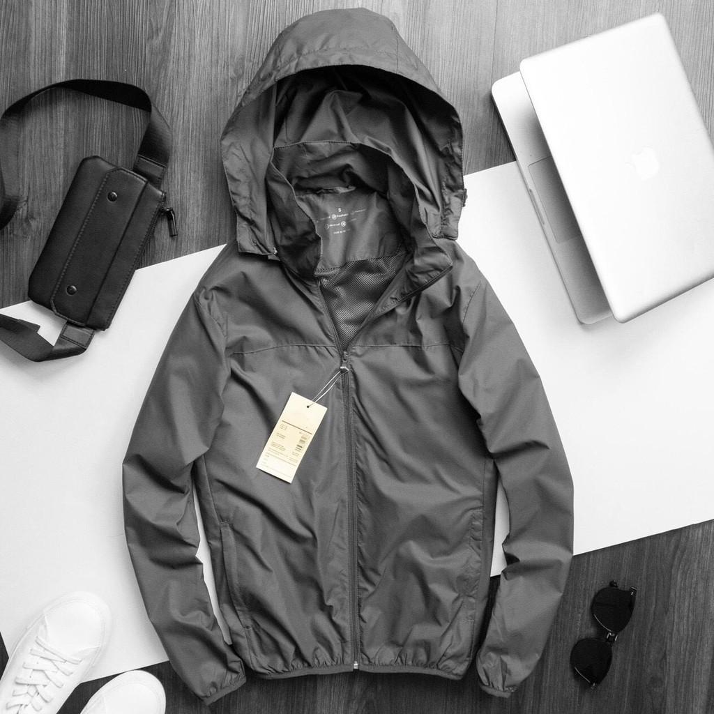 Áo khoác gió unisex nam nữ dáng thể thao chống nước có mũ, khóa túi, 4 màu trẻ trung kèm túi đựng mặc giữ ấm thu đông