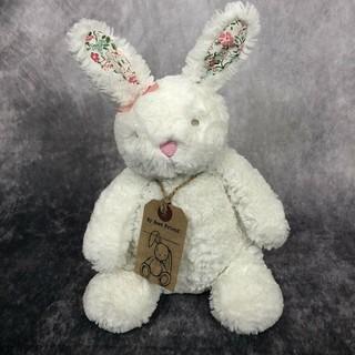 Thỏ bông trắng tai hoa đeo nơ hiệu NEXT