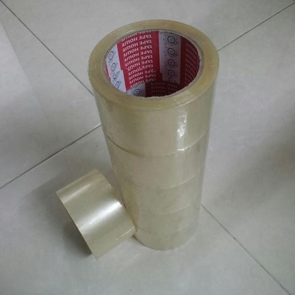 1 cuộn băng dính 0.25 kg/ cuộn (1.5kg/ cây) lõi giấy mỏng 3 ly