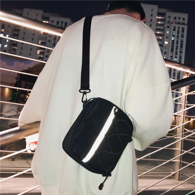 กระเป๋าแบรนด์ Tide ผู้ชายถุงเล็กชายหญิงแบรนด์น้ำสบาย ๆ กระเป๋า Messenger สะท้อนแสงผู้ชายกีฬานักเรียนกระเป๋าสะพายผ้าใบ