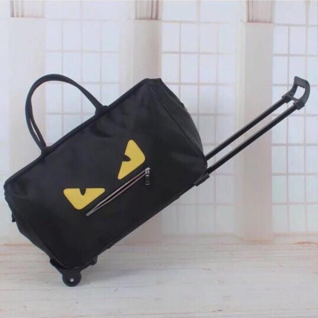 [GIÁ TỐT]Túi du lịch mắt vàng có tay kéo - Vali kéo, trọng lượng tối đa 20kg
