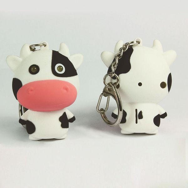 Móc khóa bò sữa mặt ngố có nhạc đèn siêu cute