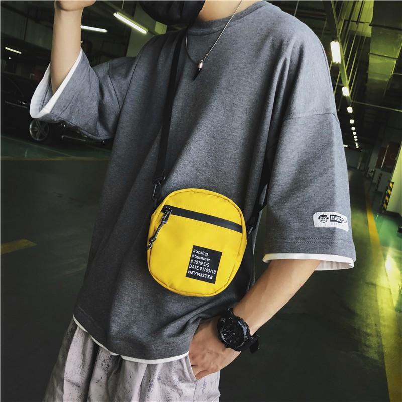 กระเป๋าแบรนด์ Tide ผู้ชายเวอร์ชั่นญี่ปุ่นและเกาหลีของกีฬาฮิปฮอปแบรนด์น้ำของ Messenger กระเป๋ามินิการเดินทางเพื่อการพักผ่