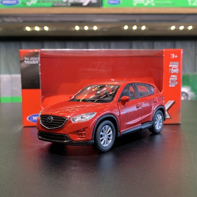 Mô hình xe ô tô Mazda Cx5 tỉ lệ 1:36 hãng Welly màu đỏ