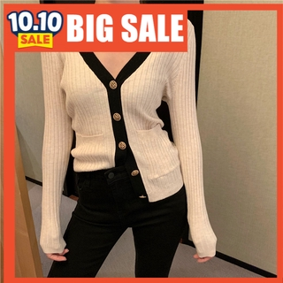 Bump slimmed long-sleeved knitted cardigan.