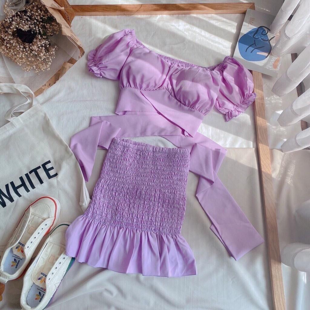 Sét áo và chân váy nữ màu tím dễ thương, áo croptop thắt nơ sau lưng phối chân váy nhún đuôi cá thích hợp mặc đi dự tiệc