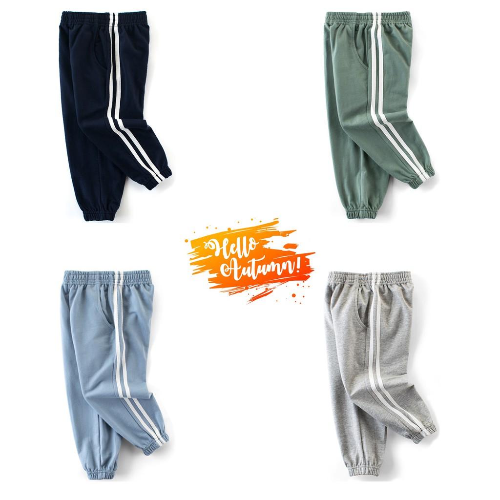 Quần thun bé trai 27KIDS quần dài cho bé họa tiết thể thao chất cotton hàng xuất Âu Mỹ