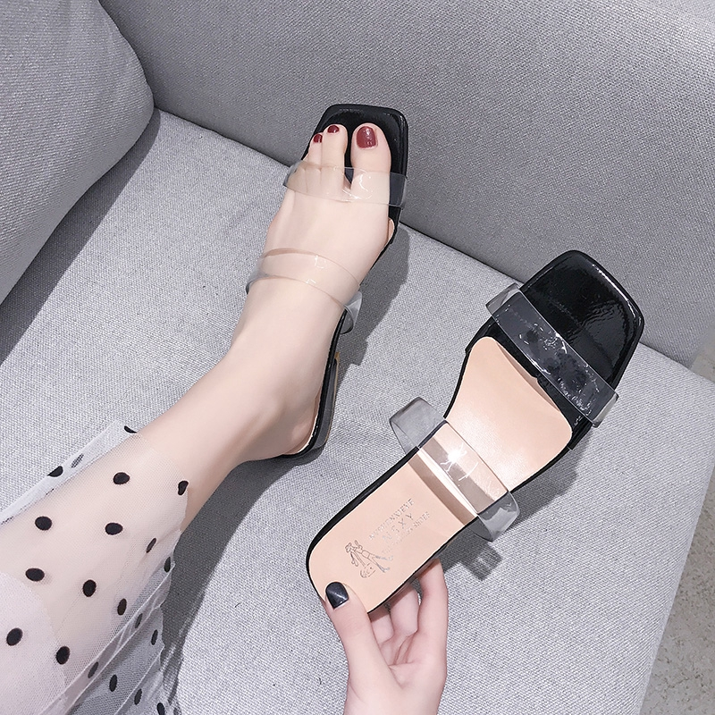 ✙▣Net red cool slippers women wear the 2019 summer new ins tide ultra-fire fashion set-up transparent bold heel drag