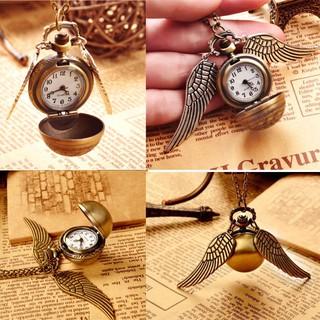 Dây chuyền mặt đồng hồ quả lắc và đôi cánh độc đáo trong Harry Potter