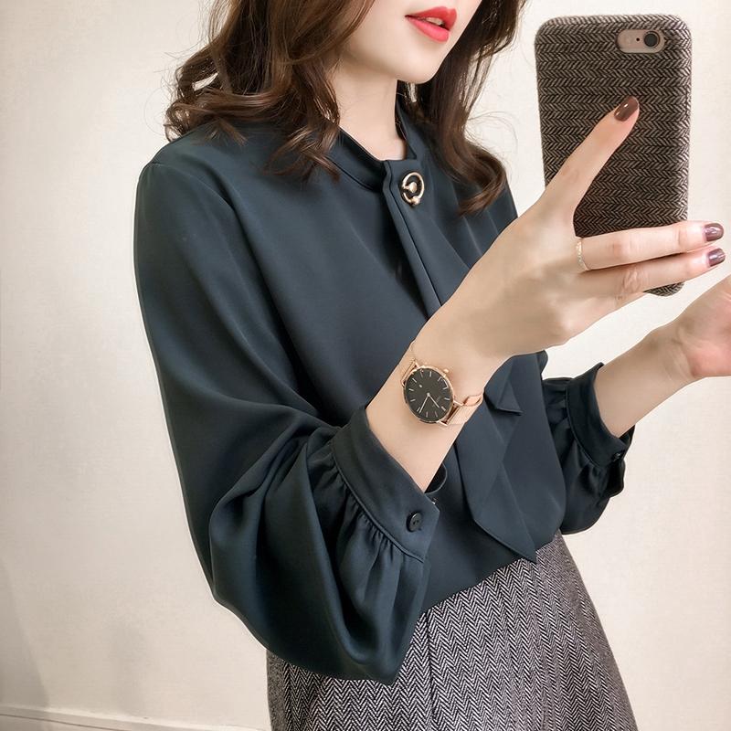Áo tay phồng màu trơn thiết kế dáng rộng cho nữ