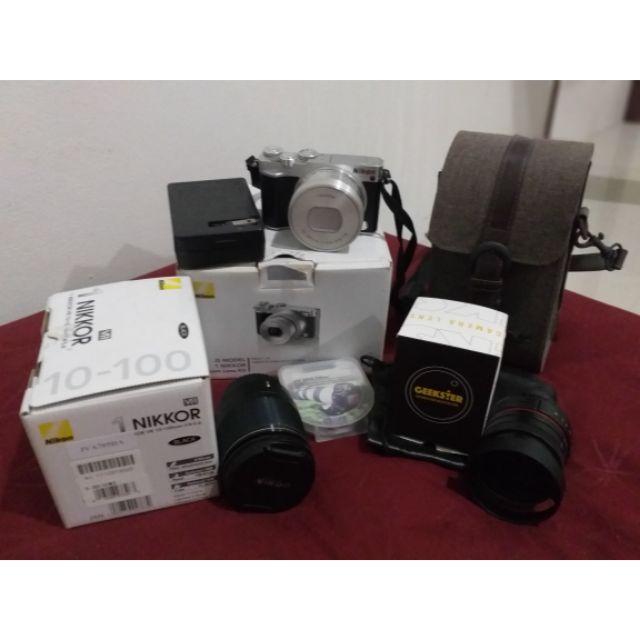 กล้อง Milerless NIKON J5 + LENS nikon 10-100 mm.+lens มือหมุน 50 mm. F 1.8 แถมกระเป๋ากล้องและเลนส์กันแสง