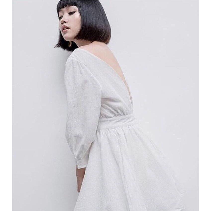 Đầm trắng hở lưng sau