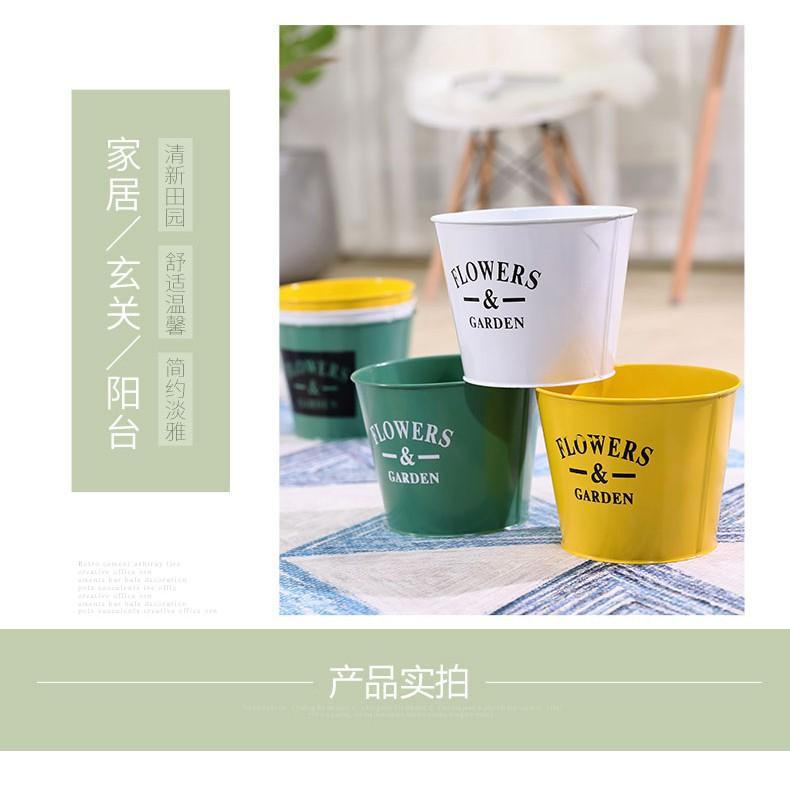 Idyllic retro old flower pots iron bucket flower bucket wrought iron flowers iro