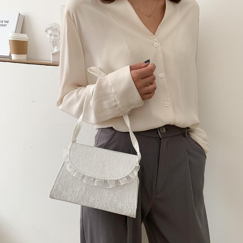 Túi xách vải ren thắt nút phong cách thời trang nữ