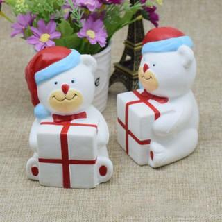 Squishy – Gấu trắng ôm quà giáng sinh (11x8x8cm) shop khobansilc