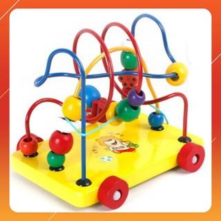 Đồ chơi gỗ luồn hạt – Xe kéo luồn hạt giúp bé phát triển tư duy .