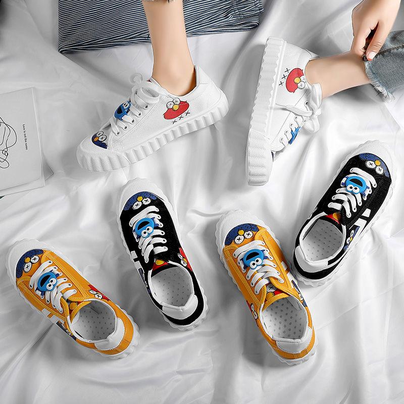 Giày Canvas Màu Trắng Kiểu Dáng Đơn Giản Trẻ Trung Thời Trang Nữ