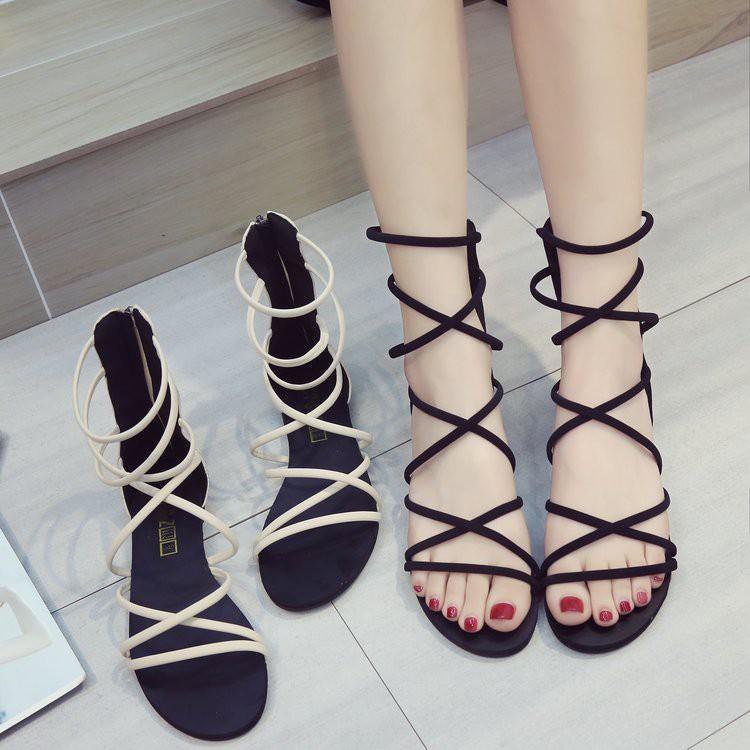 รองเท้าหญิงรองเท้าแตะโรมันใหม่หญิงสายรัดข้ามชายหาดแบนเปิดนิ้วเท้ารองเท้าผู้หญิงโบฮีเมียนวันหยุด