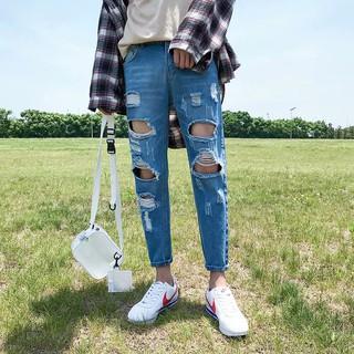 phiên bản của xu hướng 乞丐 jeans bến cảng gió bf Slim thẳng hoang dã 9 chín quần