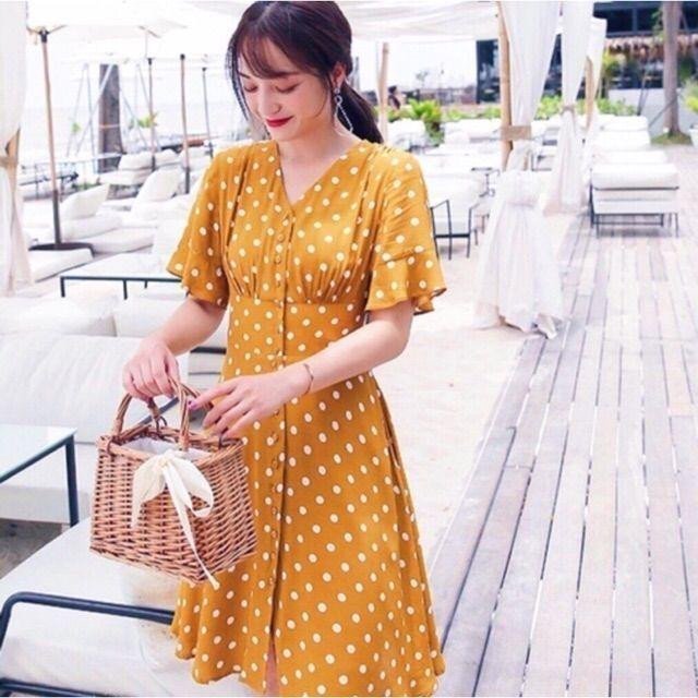 Đầm bi vàng thun eo