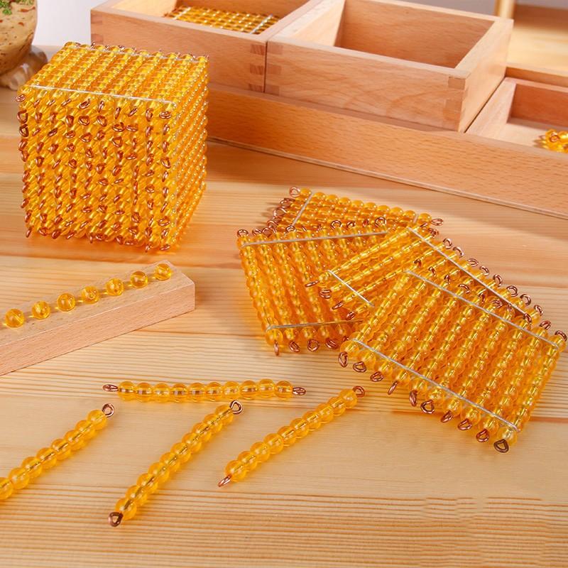 Giáo cụ Montessori - Bộ cườm vàng hệ thập phân