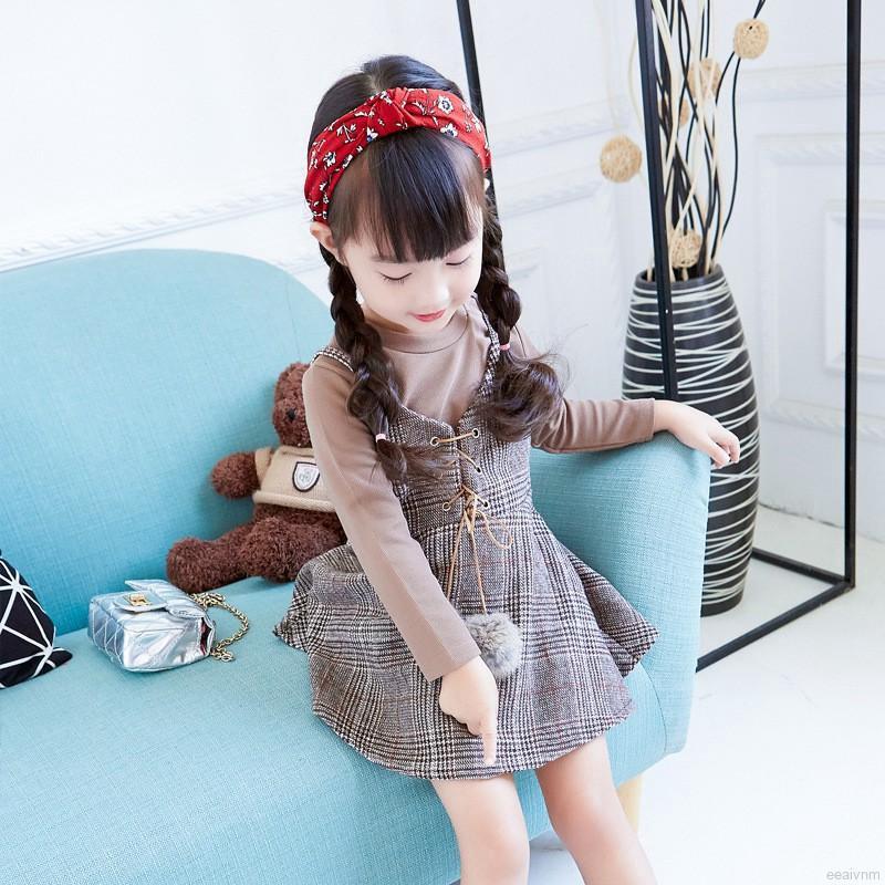 Bộ yếm sọc có dây thắt cục bông xinh xắn phối áo thun tay dài sáng màu thời trang cho bé gái