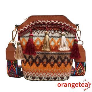 Túi đeo vai màu thổ cẩm đính núm tua độc đáo