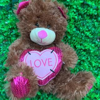 Gấu bông teddy nâu ôm tim lông ánh kim tuyến
