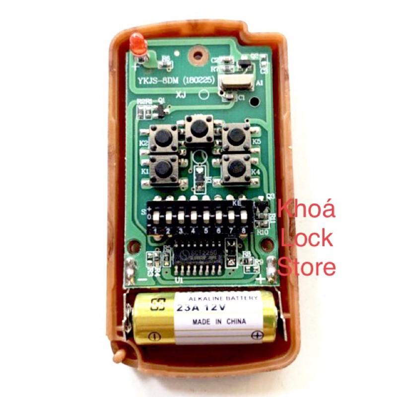 Remote điều khiển cửa cuốn 2200 8 mã gạt