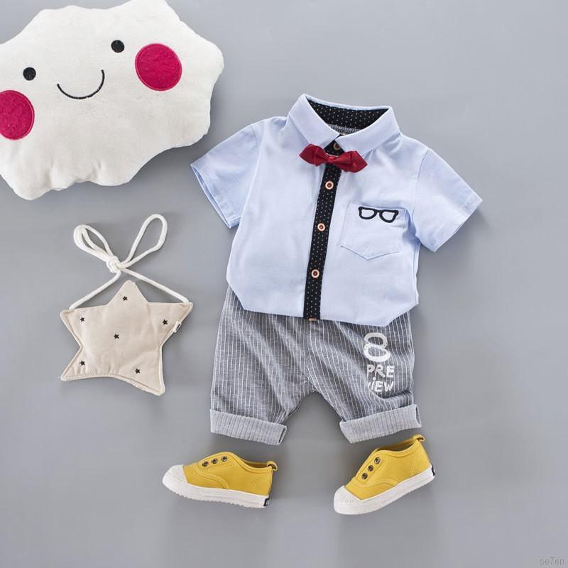 Bộ quần short và áo in chữ cho bé trai