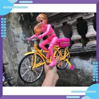 Đồ chơi búp bê đạp xe đạp (TC0012)