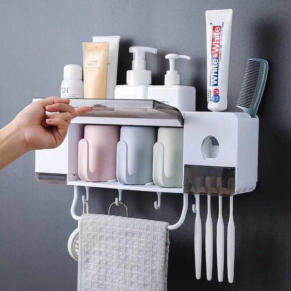 Giá để đồ nhà tắm kèm dụng cụ nhả kem đánh răng thông minh