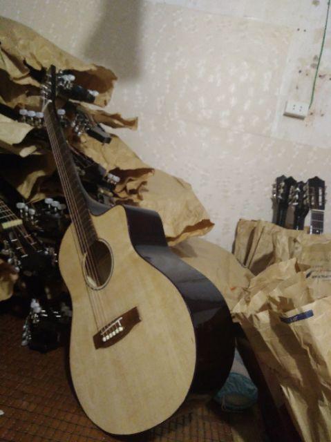 Guitar Acoustic gỗ thông màu vân gỗ tự nhiên có ty chỉnh cần. Tặng bao đựng,dây dự phòng