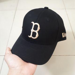 Mũ lưỡi trai B đen vàng