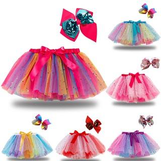 Set chân váy vải tuyn màu cầu vồng và kẹp tóc nơ dùng làm trang phục nhảy múa cho bé gái