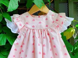 Váy cánh tiên bé gái hồng hoạ tiết trái tim