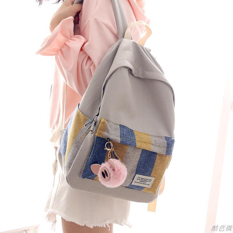 แฟชั่น NR สีลายกระเป๋าผ้าใบขนาดเล็กสดหญิงเกาหลีกระเป๋าเป้สะพายหลังกระเป๋าเป้สะพายหลังนักเรียนมัธยม