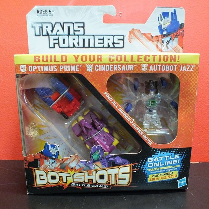 Bộ 3 Robot Transformer Mini Bot Shots - Cindersaur, Optimus Prime Và  Autobot Jazz (Box)