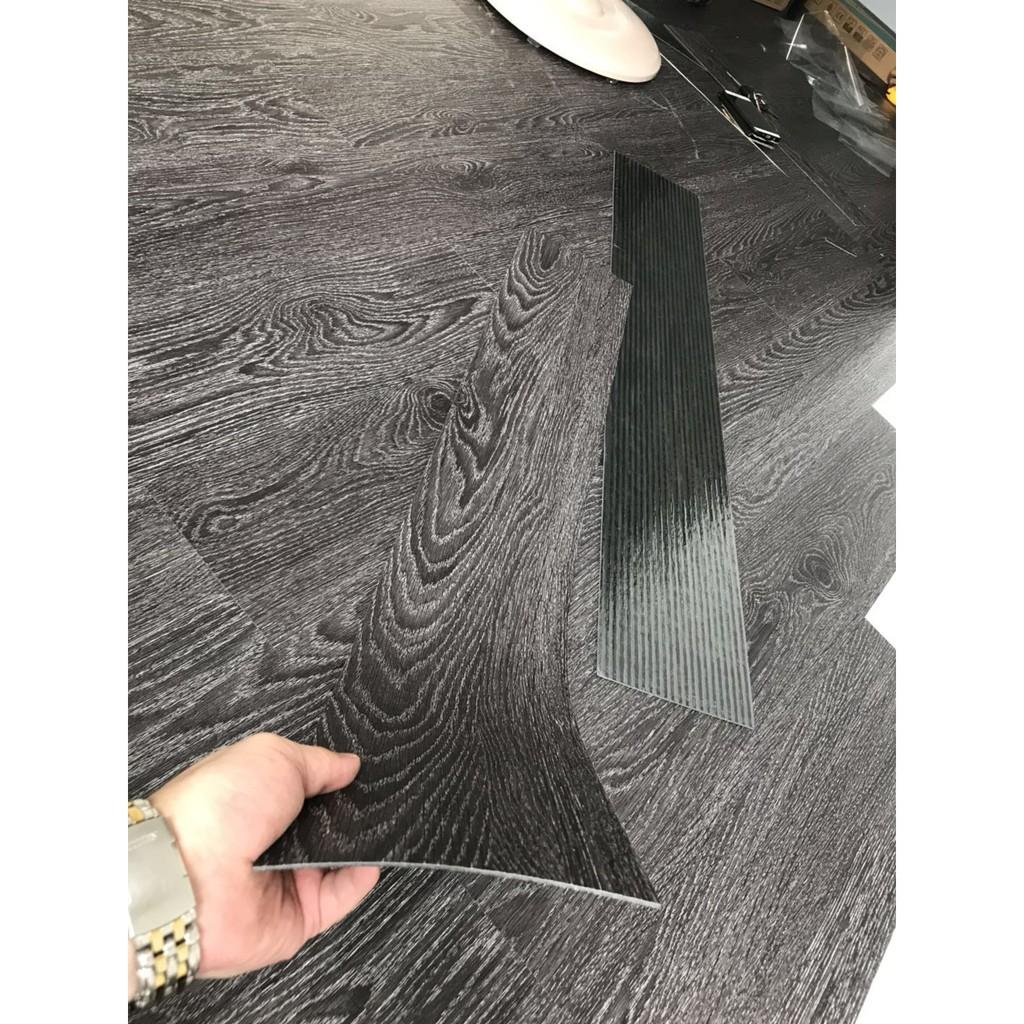 Tấm sàn nhựa giả gỗ cao cấp chống thấm chống trầy tẩm sẵn keo
