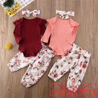 Bộ trang phục gồm áo liền quần tay dài cổ tròn quần dài kèm nơ dễ thương cho bé gái mới sinh
