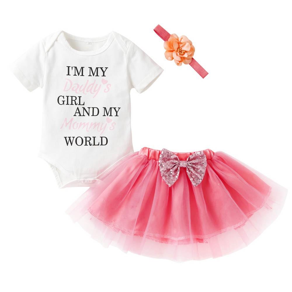 1175680751 - Bộ liền in chữ + chân váy xòe + băng đô đính hoa cho bé