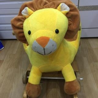 Bập bênh thú sư tử quà tặng từ tã