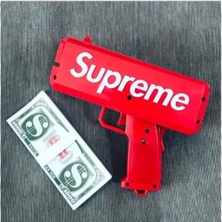 Súng bắn tiền Supreme tặng kèm 100 tờ tiền dolar