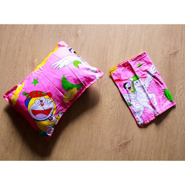 Vỏ gối trẻ em màu hồng doraemon vàng có cánh thiên thần cho bé gái chất cotton giá rẻ uy tín chất lư