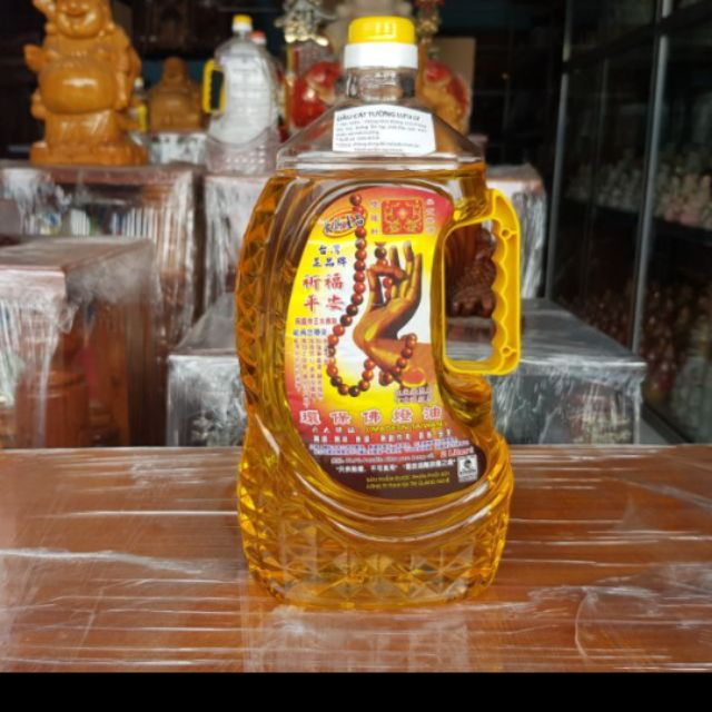 Chai dầu cát tường lưu ly 2lít màu vàng.  (  1 thùng 6 chai. )